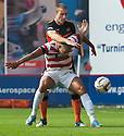 Dundee Utd's Sean Dillon goes into the back of Hamilton's Mickaël Antoine-Curier.