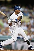 Los Angeles Dodgers outfielder Juan Rivera #33 bats against the Colorado Rockies at Dodger Stadium on July 26, 2011 in Los Angeles,California. Los Angeles defeated Colorado 3-2.(Larry Goren/Four Seam Images)