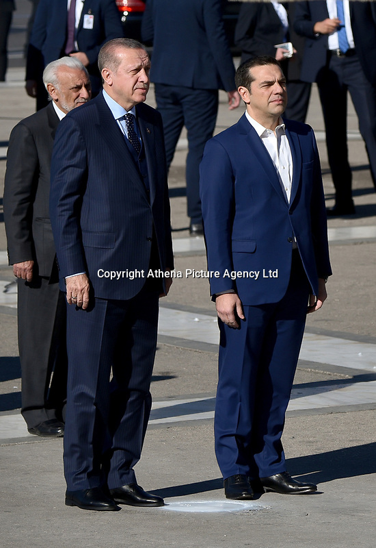 Pictured: Turkey president Recep Tayyip Erdogan, accompanied by Prime Minister Alexis Tsipras, deposits a wreath at the Unknown Soldier Monument outside the Greek Parliament in Syntagma Square.<br /> Re: Turkey's president Recep Tayyip Erdogan has begun a landmark visit to Greece. Thursday 07 December 2017