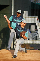 Lynchburg Hillcats pitcher Shao-Ching Chiang (30) throwing in the bullpen before a game against the Myrtle Beach Pelicans at Ticketreturn Field at Pelicans Ballpark on April 15, 2017 in Myrtle Beach, South Carolina. Pitching coach Rigo Beltran (47) stands behind him. Lynchburg defeated Myrtle Beach 5-3. (Robert Gurganus/Four Seam Images)