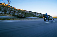 Person driving a motorbike on a freeway, Provence, France.