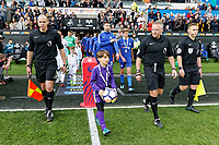 Referee Jonathan Moss leads teams out of the tunnel during the Premier League game between Swansea City v Chelsea at the Liberty Stadium, Swansea, Wales, UK. Saturday 28 April 2018