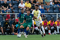 HARTFORD, CT - AUGUST 17: Darwin Lom #24 of Hartford Athletic passes the ball as Frank Nodarse #25 of Charleston Battery defends during a game between Charleston Battery and Hartford Athletic at Dillon Stadium on August 17, 2021 in Hartford, Connecticut.