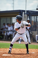 GCL Yankees West second baseman Borinquen Mendez (4) at bat during the second game of a doubleheader against the GCL Yankees East on July 19, 2017 at the Yankees Minor League Complex in Tampa, Florida.  GCL Yankees West defeated the GCL Yankees East 3-1.  (Mike Janes/Four Seam Images)