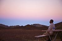 Man meditating at sunrise in the Halekala crater