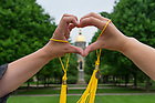 May 17, 2015; Graduates join hands as they make the shape of a heart in front of the Golden Dome shortly before the Commencement Ceremony. (Photo by Barbara Johnston/University of Notre Dame)