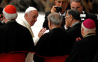 Papa Francesco incontra i Cavalieri dell'Ordine del Santo Sepolcro in Aula Paolo VI, Citta' del Vaticano, 13 settembre 2013.<br /> Pope Francis greets some cardinals during his meeting with Knights of the Order of the Holy Sepulchre at the Paul VI hall, Vatican, 13 September 2013.<br /> UPDATE IMAGES PRESS/Riccardo De Luca<br /> <br /> STRICTLY ONLY FOR EDITORIAL USE