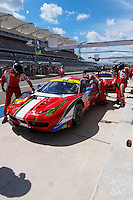 Stephen Wyatt / Michele Rugolo / Andrea Bertolini of AF Corse (81) LMGTE Am Ferrari F458 Italia in the pit road during FIA World Endurance Challenge, Thursday, September 18, 2014 in Austin, Tex. (Gary Faulkenberry/TFV Media via AP Images)