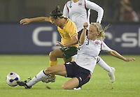 Australia forward (11) Lisa DeVanna is tackled by Norway defender (3) Gunhild Folstad during their first round game at the 2007 FIFA Women's World Cup at Hangzhou Dragon Stadium in Hangzhou, China.  Norway tied Australia, 1-1.