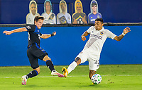 CARSON, CA - OCTOBER 14: Carlos Fierro #21 of the San Jose Earthquakes and Julian Araujo #22 of the Los Angeles Galaxy battle for a ball during a game between San Jose Earthquakes and Los Angeles Galaxy at Dignity Heath Sports Park on October 14, 2020 in Carson, California.