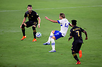 LOS ANGELES, CA - SEPTEMBER 02: Cade Cowell #44 of the San Jose Earthquakes passes off the ball between Tristan Blackmon #27 and Latif Blessing #7 of LAFC during a game between San Jose Earthquakes and Los Angeles FC at Banc of California stadium on September 02, 2020 in Los Angeles, California.