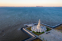 Waves from Bohai Bay lap near the world's tallest Mazu Statue of the Chinese Sea Goddess, in the Tianjin Binhai Mazu Cultural Park. Much of the port area in Tianjin has been built on reclaimed land and has been highlighted as being particularly vulnerable to sea level rise and storm surges. China, 2019.