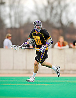 10 April 2011: University at Albany Great Dane midfielder Brian Caufield, a Senior from Bay Shore, NY, in action against the University of Vermont Catamounts on Moulton Winder Field in Burlington, Vermont. The Catamounts defeated the visiting Danes 11-6 in America East play. Mandatory Credit: Ed Wolfstein Photo
