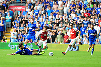 Lucas Torreira of Arsenal is fouled by Harry Arter of Cardiff City during the Premier League match between Cardiff City and Arsenal at Cardiff City Stadium in Cardiff, Wales, UK. September 2, 2018
