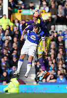 Pictured: Ashley Williams of Swansea heads the ball over Tony Hibbard of Everton. Sunday 16 February 2014<br /> Re: FA Cup, Everton v Swansea City FC at Goodison Park, Liverpool, UK.