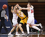 SIOUX FALLS, SD - MARCH 8: Rocky Kreuser #34 of the North Dakota State Bison passes between defenders Kruz Perrott-Hunt #5 and Tasos Kamateros #34 of the South Dakota Coyotes during the Summit League Basketball Tournament at the Sanford Pentagon in Sioux Falls, SD. (Photo by Richard Carlson/Inertia)