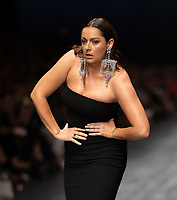 Comedian Celeste Barber closes the Runway 3 show of the 2020 Virgin Australian Melbourne Fashion at the Royal Exhibition Building in Melbourne, Australia. Photo Sydney Low