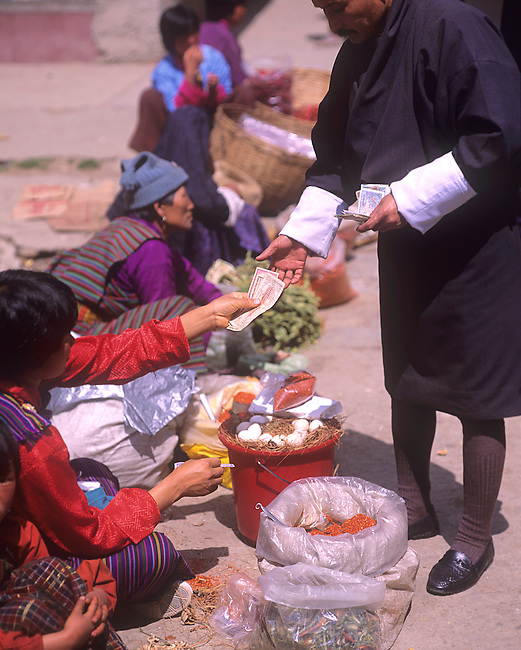 Exchanging Currency for Goods at Market, Thimphu, Bhutan