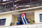 Man On Balcony With Cuban Flag