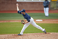 Wingate Bulldogs relief pitcher Alex Rodriguez (22) delivers a pitch to the plate against the Concord Mountain Lions at Ron Christopher Stadium on February 1, 2020 in Wingate, North Carolina. The Bulldogs defeated the Mountain Lions 8-0 in game one of a doubleheader. (Brian Westerholt/Four Seam Images)