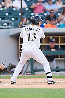 Carlos Sanchez (13) of the Charlotte Knights at bat against the Norfolk Tides at BB&T Ballpark on May 21, 2014 in Charlotte, North Carolina.  The Tides defeated the Knights 10-3.  (Brian Westerholt/Four Seam Images)