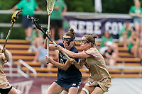 NEWTON, MA - MAY 22: Kathleen Roe #6 of Notre Dame on the attack as Melanie Welch #13 of Boston College defends during NCAA Division I Women's Lacrosse Tournament quarterfinal round game between Notre Dame and Boston College at Newton Campus Lacrosse Field on May 22, 2021 in Newton, Massachusetts.
