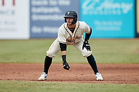 Jared Triolo (19) of the Greensboro Grasshoppers takes his lead off of first base against the Rome Braves at First National Bank Field on May 16, 2021 in Greensboro, North Carolina. (Brian Westerholt/Four Seam Images)