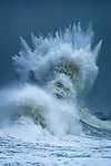 Wave forms the shape of a greek god by Mathieu Rivrin