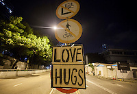 A sign advertising Love and Hugs is seen on the first day of Occupy Hong Kong, Hong Kong, China, 29 September 2014. Several areas of the city including Central, Admiralty, Causeway Bay, as well as Mong Kok in Kowloon, were locked down by Occupy Central civil disobedience teams who fanned out across the city blocking major thoroughfares as well as side streets, with rip ties, metal barriers, police road cones and any other street furniture available to hand.