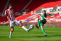 5th April 2021; Bet365 Stadium, Stoke, Staffordshire, England; English Football League Championship Football, Stoke City versus Millwall; Scott Malone of Millwall takes a shot on goal