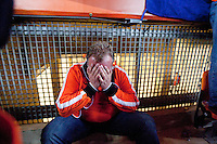A Netherlands fans reacts to Holland losing the 2010 FIFA World Cup Final between Spain and Holland at Soccer City in Soweto, South Africa on Sunday, July 11, 2010.  Spain defeated Netherlands 1-0.