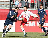 Doug Rodkey #5 of the University of Maryland flicks the ball over Pat Marion #20 of the University of California during an NCAA championship round of sixteen soccer match at Ludwig Field, on November 29, 2008 in College Park, Maryland. The match was won by Maryland 2-1