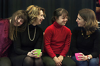 Switzerland. Canton Ticino. Locarno. Fauni Theater.  MOPS_DanceSyndrome is an independent Swiss artistic, cultural and social organisation operating in the field of contemporary dance and disability. It is composed only of Down dancers. Family meeting (left to right): Gaia and Paola Frezza Mereu. Elisabetta and Giulia Montobbio. Down syndrome (DS or DNS), also known as trisomy 21, is a genetic disorder caused by the presence of all or part of a third copy of chromosome 21 It is usually associated with physical growth delays, mild to moderate intellectual disability, and characteristic facial features. 19.12.2019 © 2019 Didier Ruef