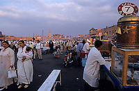 Man selling food in the crowded market at Djemaa el Fna, Marrakesh, Morocco