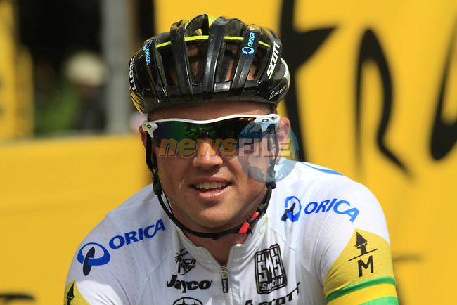 Simon Gerrans (AUS) Orica GreenEdge at sign on before the start of Stage 1 of the 99th edition of the Tour de France, running 198km from Liege to Seraing starting in Parc d'Avroy Liege, Belgium. 1st July 2012.<br /> (Photo by Eoin Clarke/NEWSFILE)