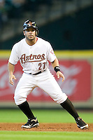 Houston Astros second baseman Jose Altuve #27 leads off of first base during the Major League Baseball game against the Philadelphia Phillies at Minute Maid Park in Houston, Texas on September 14, 2011. Philadelphia defeated Houston 1-0.  (Andrew Woolley/Four Seam Images)