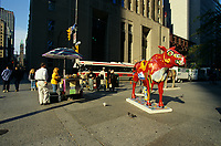 2000 File Photo Toronto (ON) CANADA.People stop at a hot dog stand beside a Moose sculpture,. in downtown Toronto .Photo : (c) 2000 Pierre Roussel