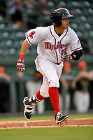 Right fielder Chris Madera (15) of Greenville Drive runs toward first in a game against the Greensboro Grasshoppers on Tuesday, April 25, 2017, at Fluor Field at the West End in Greenville, South Carolina. Greenville won, 5-1. (Tom Priddy/Four Seam Images)