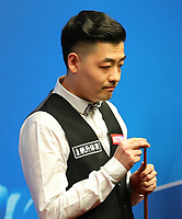 18th April 2021; Crucible Theatre, Sheffield, England; Betfred Snooker World Championships; China's Tian Pengfei competes during the first round match with Scotlands John Higgins