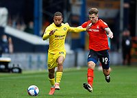 3rd October 2020; Kenilworth Road, Luton, Bedfordshire, England; English Football League Championship Football, Luton Town versus Wycombe Wanderers; James Collins of Luton Town challenges Curtis Thompson of Wycombe Wanderers