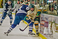 4 January 2014:  University of Vermont Catamount Forward Pete Massar, a Senior from Williston, VT, gets by a check from Yale University Bulldog defenseman Matt Killian, during the second period at Gutterson Fieldhouse in Burlington, Vermont. With an empty net and seconds remaining, the Cats came back to tie the game 3-3 against the 10th seeded Bulldogs. Mandatory Credit: Ed Wolfstein Photo *** RAW (NEF) Image File Available ***