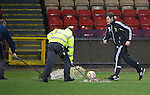 Partick Thistle v St Johnstone....14.12.13    SPFL<br /> Fourth official Alan Muir tries to run with the ball during a pitch inspection at half time, Ref Kevin Clancy abandoned the game a few minutes later<br /> Picture by Graeme Hart.<br /> Copyright Perthshire Picture Agency<br /> Tel: 01738 623350  Mobile: 07990 594431