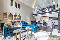 BNPS.co.uk (01202) 558833. <br /> Pic: LuxuryAndPrestige/BNPS<br /> <br /> Pictured: Open plan kitchen/living space. <br /> <br /> A heavenly converted chapel that has been transformed into a contemporary home is on the market for £1.5m.<br /> <br /> The Old Chapel was used by an order of nuns for 139 years before the humble church got a stylish upgrade into a four-bedroom property.<br /> <br /> The Grade II listed building has been carefully restored to retain stunning ecclesiastical features like windows, archways and doors, but with a modern twist.<br /> <br /> And although the owner bought it from the developer before it was finished, the stunning home has never been lived in.