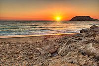 The sunset in Fragolimnionas beach of Karpathos, Greece