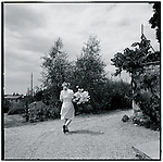 A maid prepares fresh flowers for the inn. Europe before the euro.
