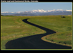 Paved road in the foothills, with the Indian Peaks Wilderness Area behind, Colorado. .  John leads private photo tours in Boulder and throughout Colorado. Year-round.