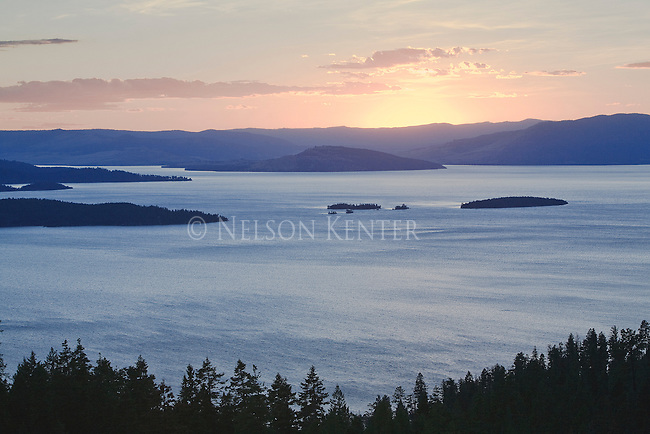 Pastel colors of sunset over the islands in Flathead Lake