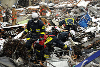 Members with the Japanese Search and Rescue team search through the damage and debris on March 17, 2011, in Unosumai, Japan. A 9.0 earthquake hit Japan on March 11 that caused a tsunami that destroyed anything in its path.
