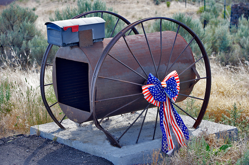 US flag ribbon on spokes of wheel of mailbox. Oregon