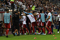 Olympiakos players celebrate a goal during the UEFA Champions League playoff first leg soccer match between Olympiakos and Krasnodar at Karaiskaki stadium in Piraeus, Greece, on 21 August 2019